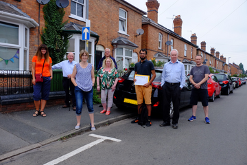 Cllrs Kaleem Aksar and Neville Mills meet with local residents to promote their parking petition